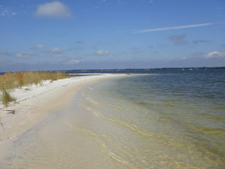 Navarre Beach condo photo - Sound Side. Miles of White Sandy Beaches to Walk Along.