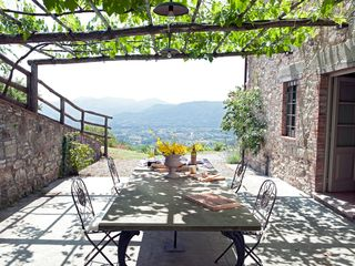Lucca villa photo - BBQ Panoramic Terrace with Big Stone Table