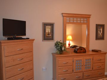 "Queen 2nd bedroom with 24"" HD 1080p TV w DVD player. Ample storage"