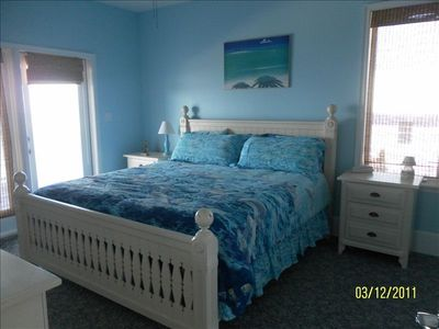 Blue dolphin bedroom on main floor with king size bed, private bath and balcony.