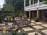Enjoy this beautiful courtyard and location while staying in historic Savannah.