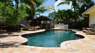 "Photo for ""The Oasis"" - 3/2 retreat with Pool, Hot Tub, Gym & Bikes, Minutes to Beach!!!"