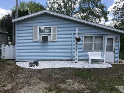 Photo for Charming Channel Front Cottage on Gun Lake