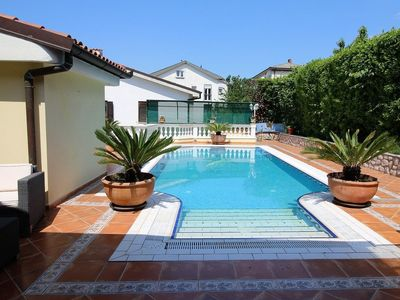 Photo for Spacious apartment with pool, great sea view from terrace with lovely garden