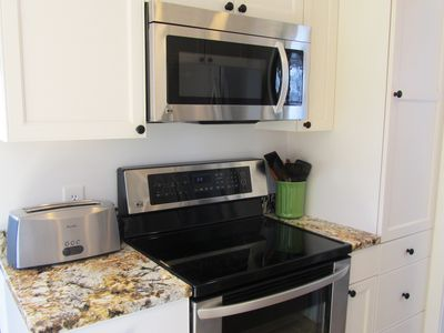 Photo for Beautiful West End town house condo with parking,pets permitted. sleeps 6