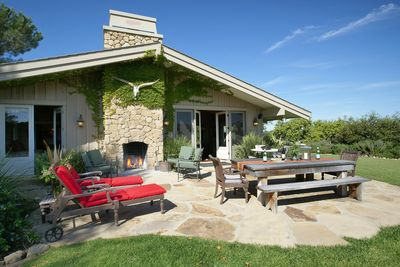 Flagstone Back Patio with outdoor fireplace