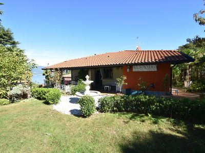 Photo for Nice villa with views of the mountains and the lake, beautiful exclusive garden