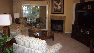 Relax in the living room with all new furniture, fireplace and 40' HDTV