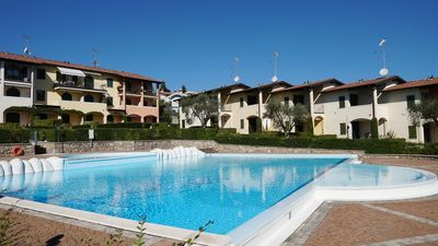 Photo for Generous Patio with Pool Access and Wi-Fi - Apartment Le Giare