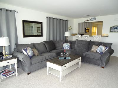 Newly furnished living room with incredible water view
