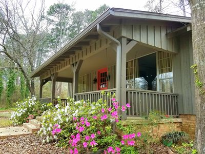 Large front porch with porch swing & Adirondack chairs