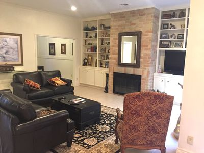Living room has wood burning fireplace