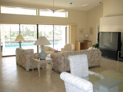 Dining room & Living room with 60' TV overlooking Pool, Spa and Canal