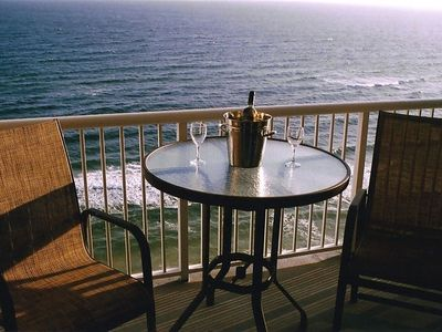 Photo for Stunning beachfront condo with panoramic views of the emerald coast.