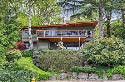 Seattle retreat perched on hillside with spectacular view of sound.