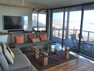 Photo for Sea views from every room of this lovely Muizenberg apartment