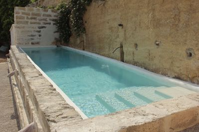 New swimming pool converted from ancient stone water tank