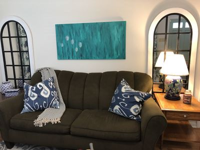 Come on in and have a seat on the comfy sofa and watch cable tv or Netflix.