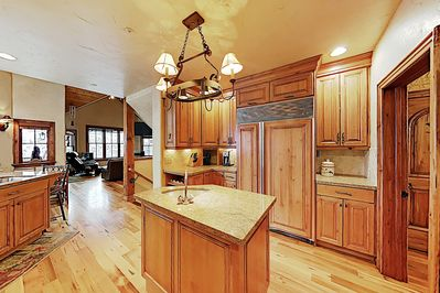 Kitchen - Channel your inner chef in a gourmet kitchen with upscale appliances and ample cookware.