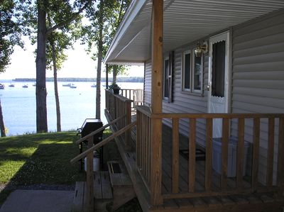 Pine Cottage (#403). The porch wraps around the lake end. It is lovely.
