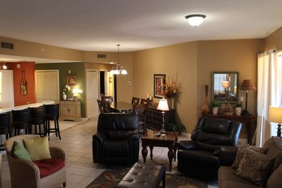 Living area with open dining & kitchen