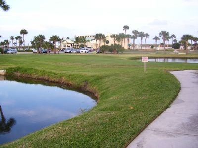 Golf green and Main Clubhouse /restaurant view. Pool and ocean near clubhouse