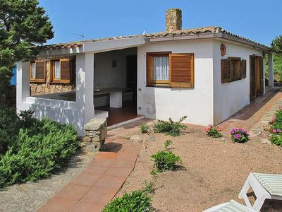 Photo for Villa a short walk from the sea surrounded by a garden with trees, plants and flowers