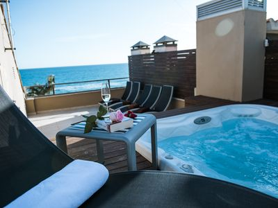 Photo for APARTMENT AT THE BEACH WITH SOLARIUM AND JACUZZI