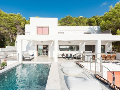 Photo for Modern villa within walkin distance of the beach, located above Cala Salada with lovely views.