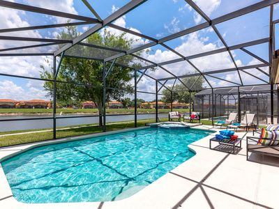 Photo for Luxurious 6 bed pool home with spa close to parks!