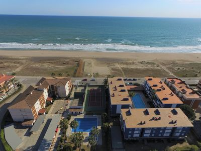 Photo for FEET IN THE WATER - APARTMENT ON THE BEACH WITH SWIMMING POOL, TENNIS ...
