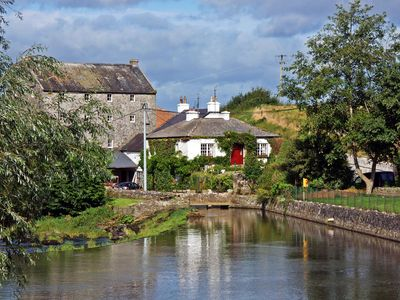 Photo for Unique mill cottage beside the River Maigue and a cut stone mill in the village of Bruree…