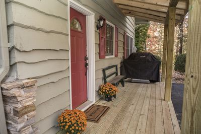 Side entrance which leads into the kitchen area and features a gas-grill.