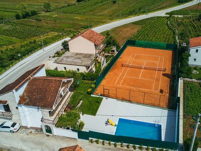 Photo for ctim301-Holidayhouse with pool and private tennis court 8+2 people
