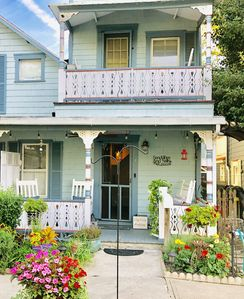 Photo for Cozy, Clean and Bright w/ Amazing Front Porch, 3 Blocks to Beach Includes Badges
