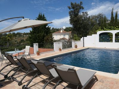 Photo for Modern spacious villa with swimming pool and with fantastic views over the hills and the sea