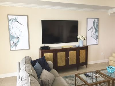 70 inch TV in Living Room with New Art