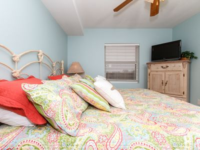 Serenity welcomes you to Pelican Isle 315 - The master bedroom features a KING size bed with plenty of extra pillows.