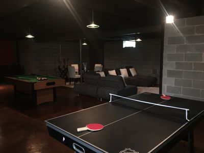 Full finished basement. Pool, air, and table tennis tables. Modern sectional