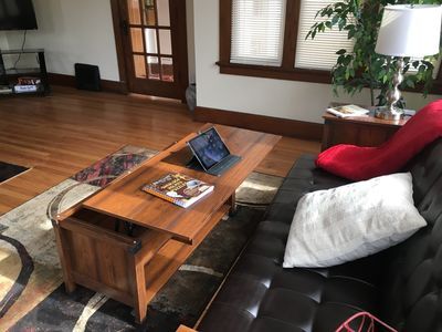 Coffee table lifts up to a desk position