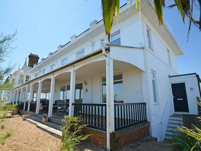 Photo for Elegant, white house with veranda, located on the coast in Deal