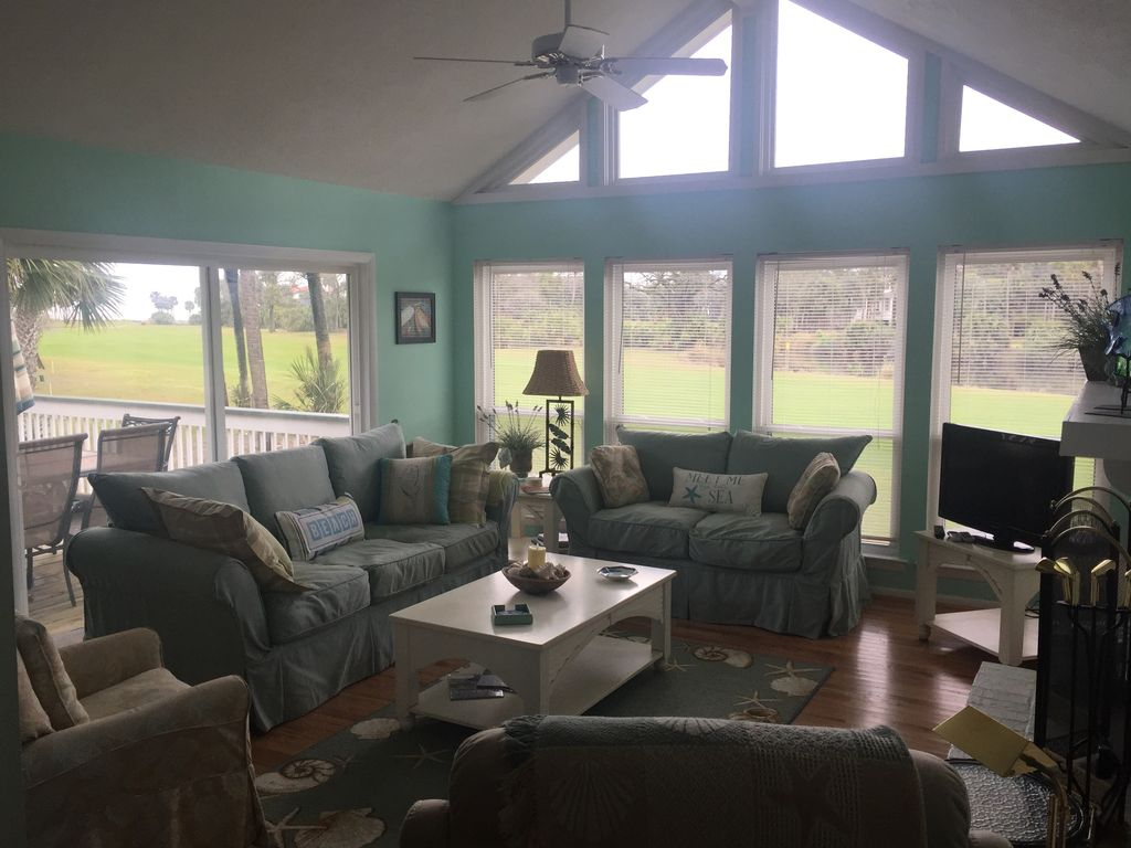 Living Room With Glimpse Of Golf Course And Deck