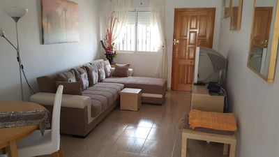 Spacious lounge with dining area, cable TV and internet.