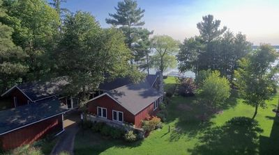Photo for Two Lake Charlevoix Waterfront Homes 8 BR's 6 1/2 Baths FREE 3 HR BOAT CRUISE AU