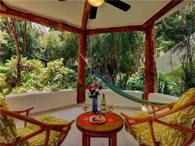 Photo for Quaint Bungalow. Lush Tropical Settings. 5MN walk to the beach Garden Unit # 129