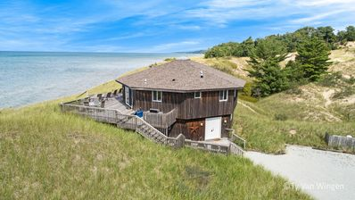 Photo for Unique octagon cottage on Lake Michigan surrounded by dunes & a county park!!
