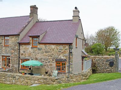 Photo for This traditional Welsh holiday cottage has a log fire and packed to the rafters with original featur