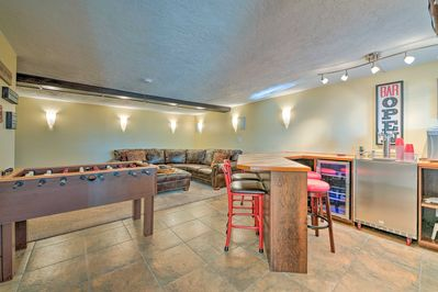 It boasts a full entertainment room complete with foosball, a bar and more!