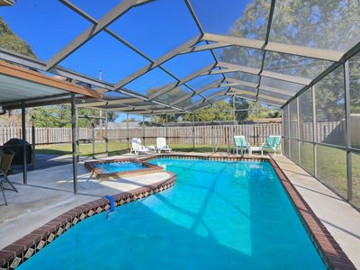 Photo for Heated Pool, Hot Tub, minutes to beach, close to everything, Golf, Ball Park,