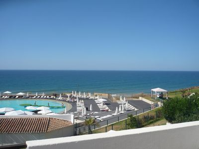 Front view of Breeze pool and sea from first floor balcon